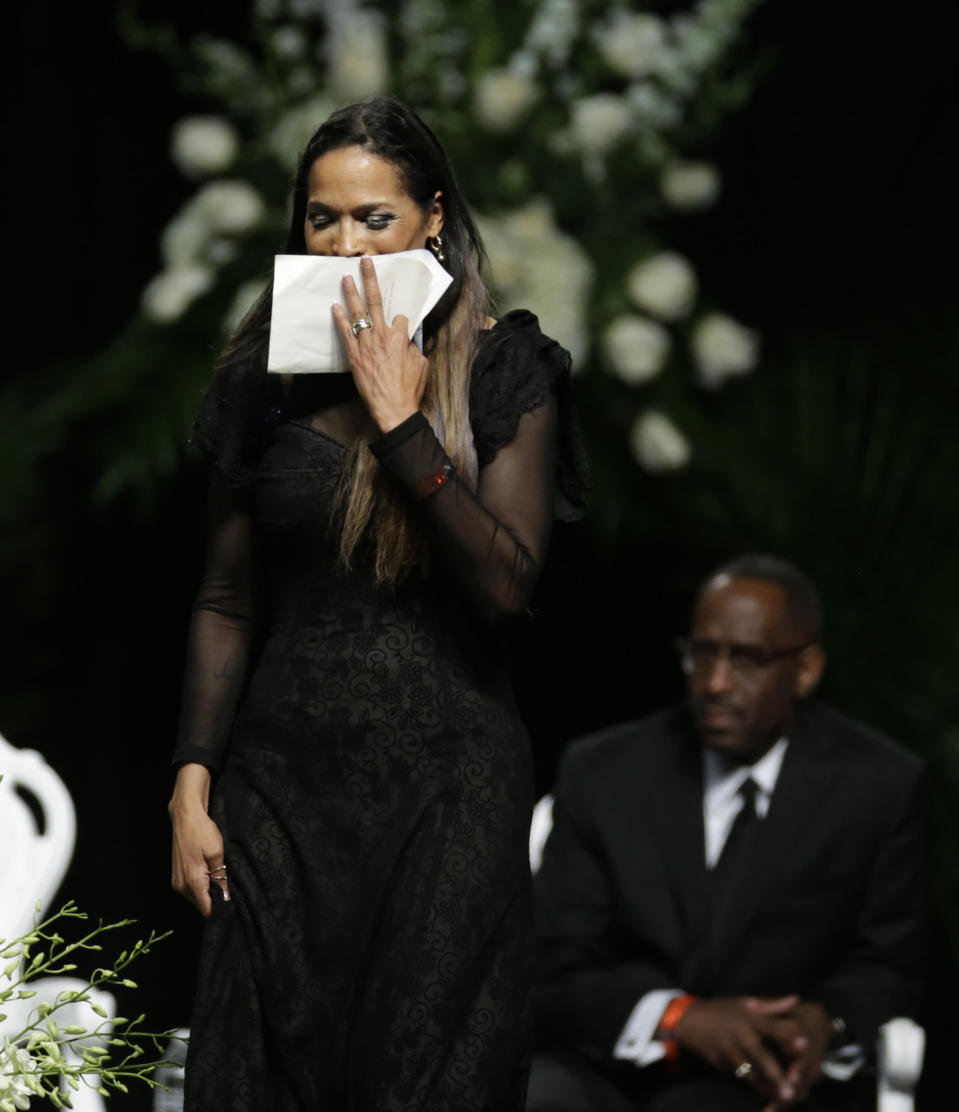 FILE - Muhammad Ali's daughter Rasheda Ali-Walsh walks off the stage after speaking during his memorial service in Louisville, Ky., in this Friday, June 10, 2016, file photo. Five years after his death, residents, as well as Ali's daughter, Rasheda, look back at the legacy of the boxer and the ways the people of Louisville have come together since his passing. (AP Photo/David Goldman)