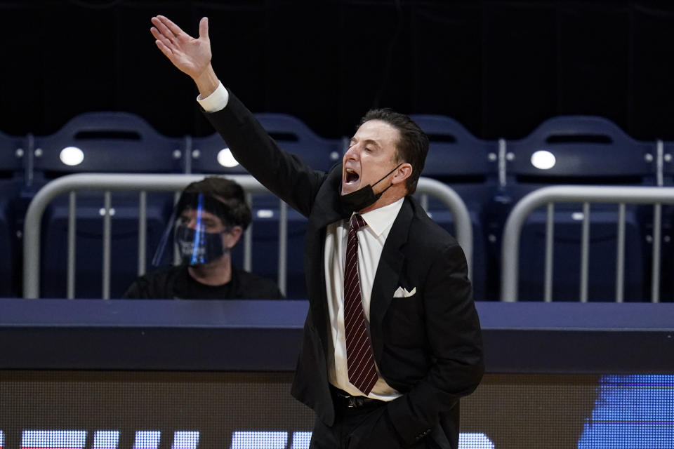 FILE - Iona head coach Rick Pitino gestures as his team plays against Alabama in the first half of a first-round game in the NCAA men's college basketball tournament at Hinkle Fieldhouse in Indianapolis, in this Saturday, March 20, 2021, file photo. Iona coach and Basketball Hall of Famer Rick Pitino is coaching the Greek national team in the Olympic qualifying tournament that starts Tuesday in Victoria, British Columbia. (AP Photo/Michael Conroy, File)