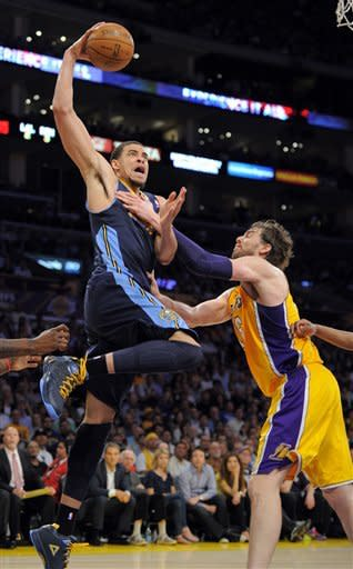 Denver Nuggets center JaVale McGee, left, goes up for a dunk as Los Angeles Lakers power forward Pau Gasol of Spain defends during the second half in Game 5 of an NBA first-round playoff basketball game, Tuesday, May 8, 2012, in Los Angeles. The Nuggets won 102-99. (AP Photo/Mark J. Terrill)