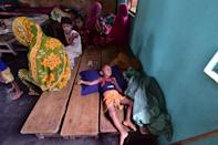 NAGAON,INDIA-JULY 22,2020 :A child sleep inside a flood relief camp at a school at Madhabpara village in Nagaon district, in the northeastern state of Assam, India- PHOTOGRAPH BY Anuwar Ali Hazarika / Barcroft Studios / Future Publishing (Photo credit should read Anuwar Ali Hazarika/Barcroft Media via Getty Images)