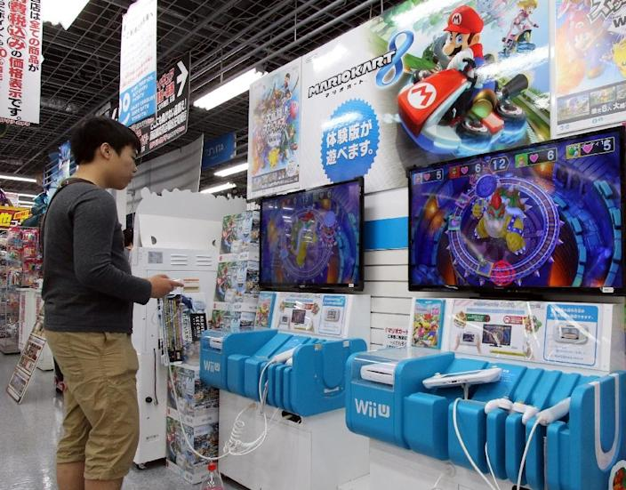 Shares in the maker of the Wii U console fell 0.51% to 19,415 yen ($158) in early trading, tumbling back from a nearly five percent jump at the open (AFP Photo/Yoshikazu Tsuno)