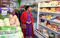 <p>During a tour of a recently opened village grocery store in Birkenhead, Meghan Markle took a peek at the store's refrigerated section. We're sure she was familiar with this aisle from her pre-royal days.</p>