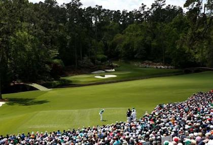 A massive gallery watches Jordan Spieth tee off on the 12th hole. (REUTERS)