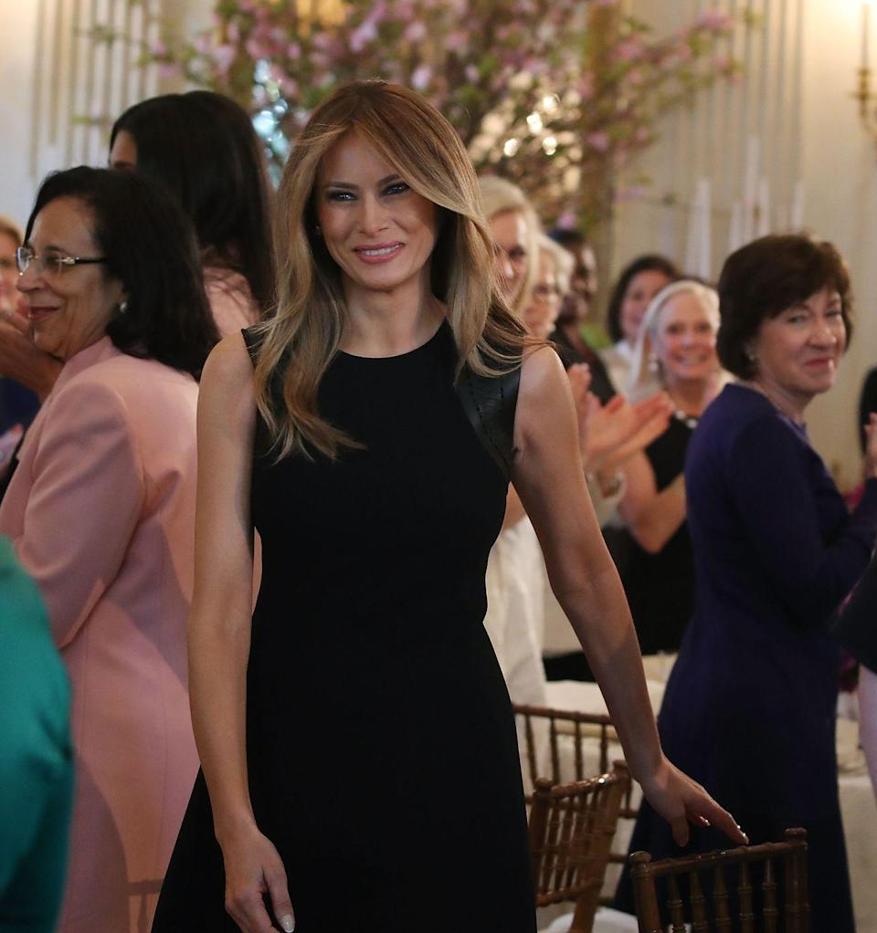 <p>For her Women's Day luncheon held at the White House, First Lady Melania wore a sleeveless Ralph Lauren dress with leather trim.</p>