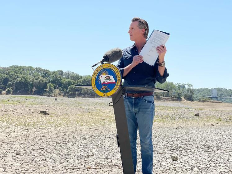 Gov. Gavin Newsom holding an emergency drought declaration for Sonoma and Mendocino counties while standing on a section of dry lakebed in Lake Mendocino.