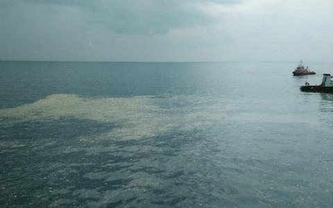 An oil slick where Lion Air flight JT 610 reportedly crashed into the sea off the coast of Indonesia's Java island - Credit: AFP