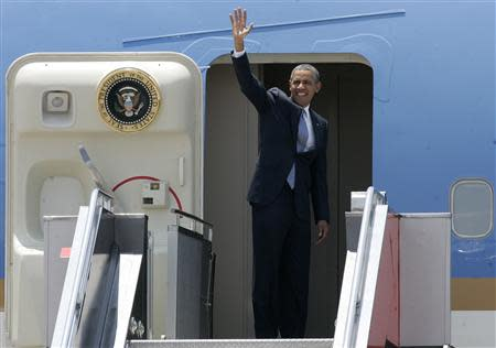 U.S. President Barack Obama waves before entering his departing flight in Manila international airport in Manila April 29, 2014. Obama arrived in Manila on Monday for a one-day visit. REUTERS/Romeo Ranoco