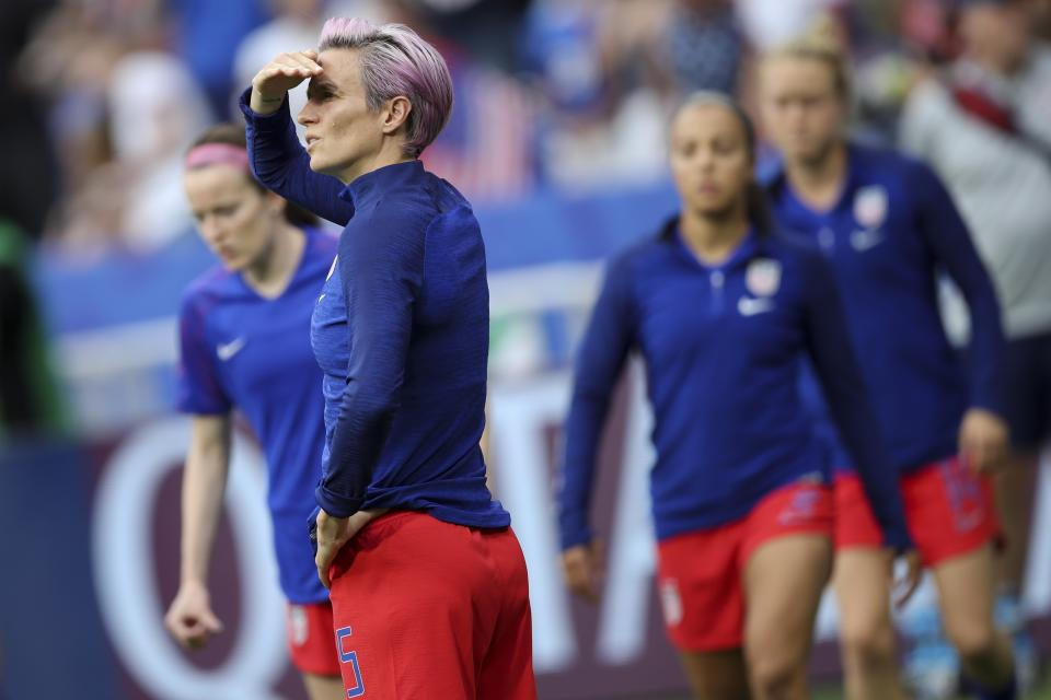 United States' Megan Rapinoe warms up before the Women's World Cup semifinal soccer match between England and the United States, at the Stade de Lyon outside Lyon, France, Tuesday, July 2, 2019. (AP Photo/Francisco Seco)