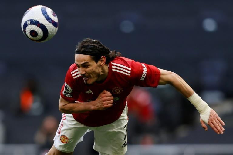 Eyes on the prize: Edinson Cavani's header helped Manchester United beat Tottenham 3-1 on Sunday