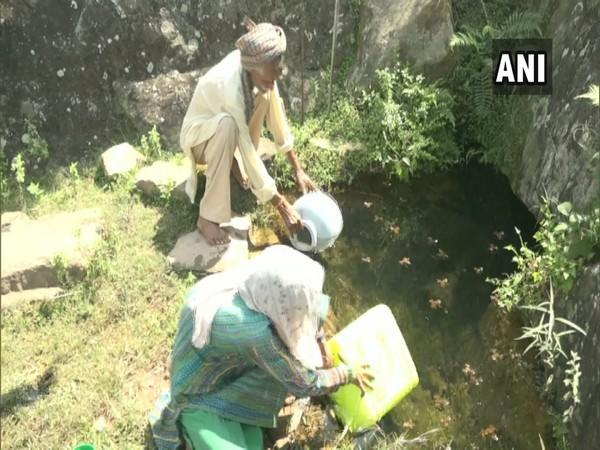 Prey villagers fetching water from a distant village's Chashma. (Photo/ANI)