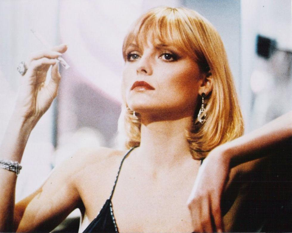 <p>The ultimate bad-girl style and beauty icon: Michelle Pfeiffer as Elvira Hancock in the 1983 film <em>Scarface</em>. Her haircut is iconic:a sleek bob with bangs and flipped ends.</p>