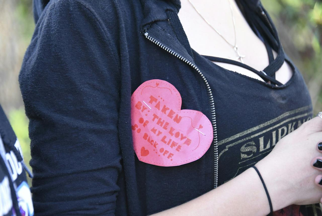 <p>A student wears a Valentine's pin as she leaves Marjory Stoneman Douglas High School in Parkland, Florida, a city about 50 miles (80 kilometers) north of Miami on Feb. 14, 2018 following a school shooting.(Photo: Michele Eve Sandberg/AFP/Getty Images) </p>