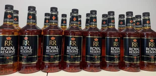 Rankin Inlet RCMP charged a 44-year-old man in January 2021 after seizing 24 bottles of alcohol as part of an ongoing investigation into allegation of bootlegging in the community . (RCMP - image credit)