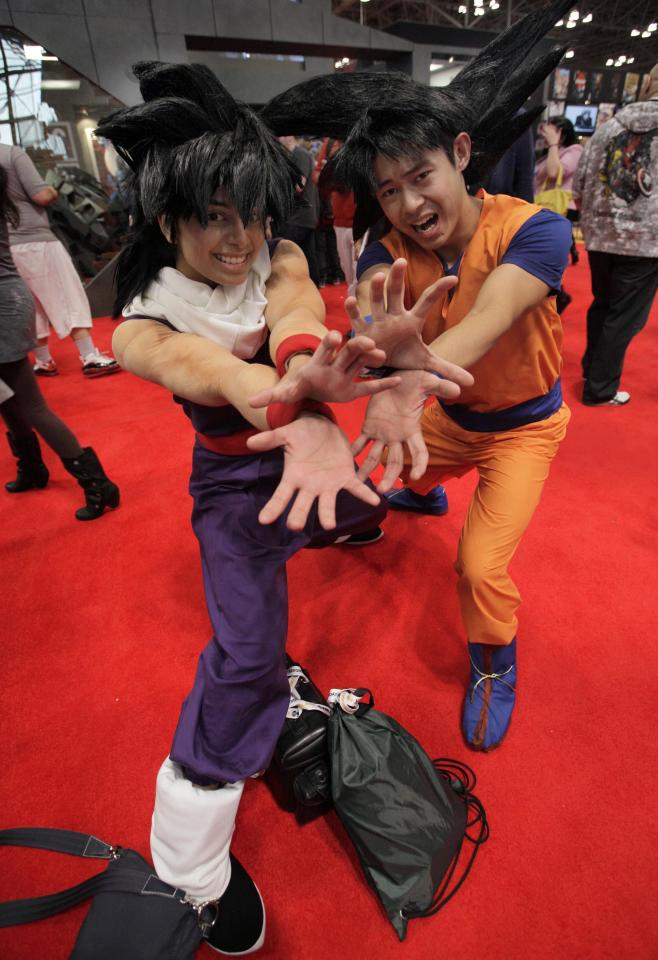 Nikki Warner, as Gohan, left, and Mike Chan, as Goku, from Dragonball Z, pose for photos at New York Comic Con 2012 at New York's Jacob K. Javits Center, Thursday, Oct. 11, 2012. The New York Comic Con show floor plays host to the latest and greatest in comics, graphic novels, anime, manga, video games, toys, movies, and television. (AP Photo/Richard Drew)