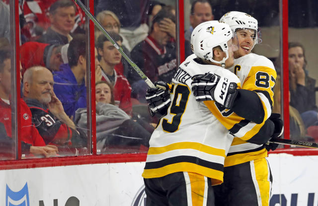 Pittsburgh Penguins' Jake Guentzel (59) is congratulated on his goal by teammate Sidney Crosby (87) during the second period of an NHL hockey game against the Carolina Hurricanes, Saturday, Dec. 22, 2018, in Raleigh, N.C. (AP Photo/Karl B DeBlaker)