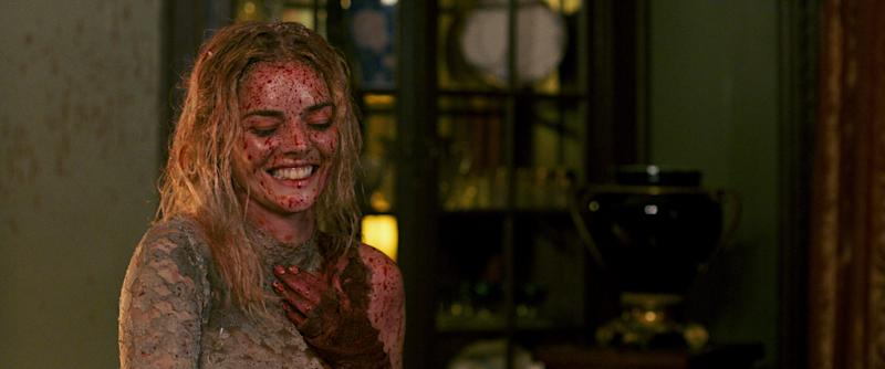 Grace (Samara Weaving) gets covered in blood and guts but still manages a grin in