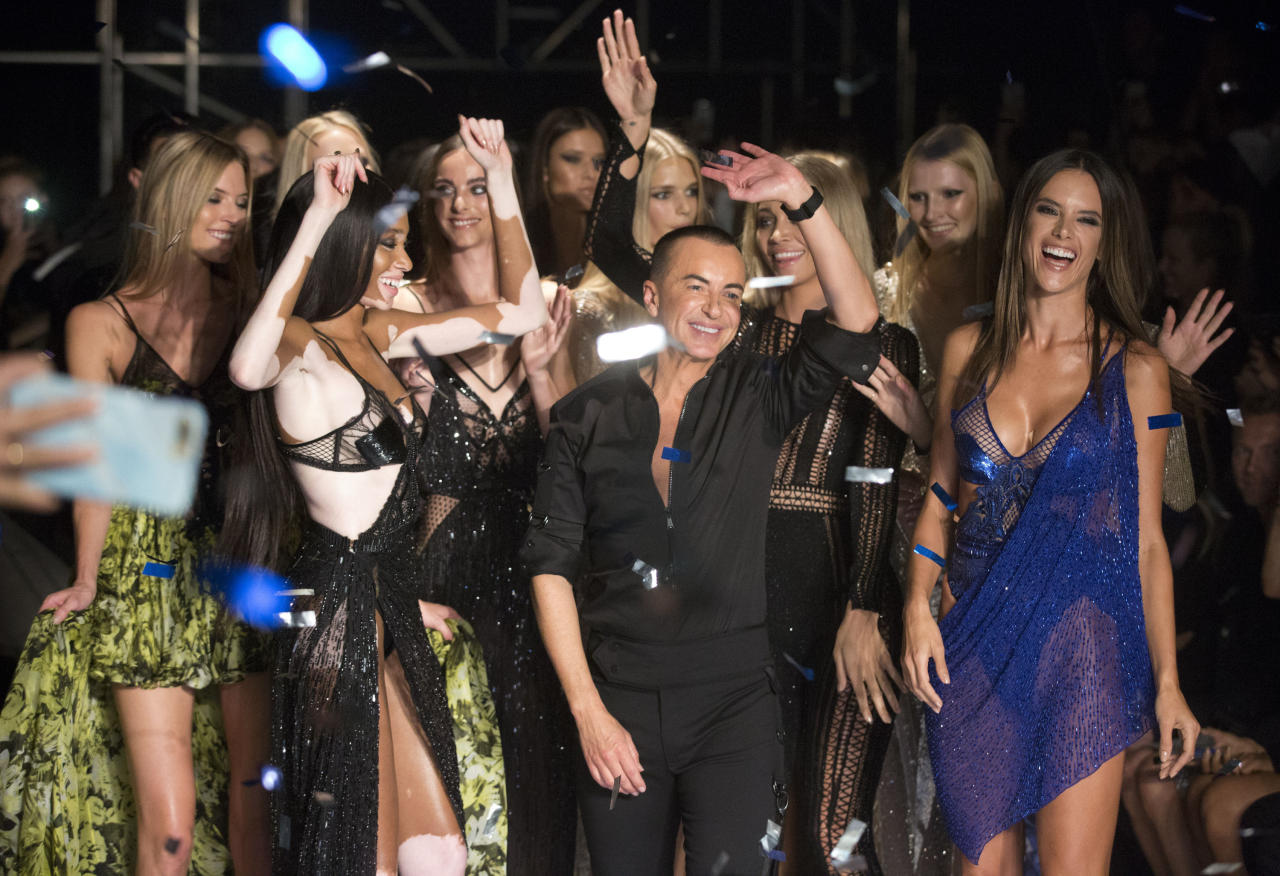 <p>Victoria Secret models Alessandra Ambrosio and Martha Hunt joined Winnie Harlow and Hailey Baldwin on the Macdonald catwalk, making it the most epic line-up of the season. <em>[Photo: PA]</em> </p>