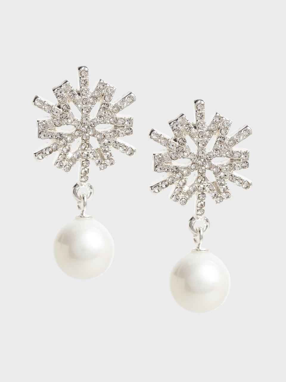 <p>We love the holiday vibes of these <span>Banana Republic Starburst Pearl Drop Earrings</span> ($28, originally $48). Almost like a beautiful snowflake!</p>