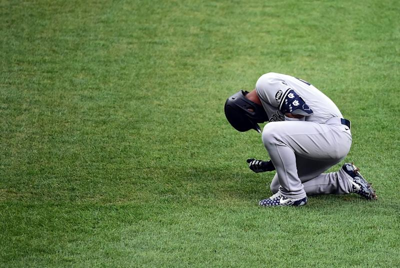 Gleyber Torres in pain after being hit by pitch