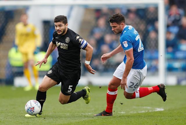 """Soccer Football - League One - Portsmouth vs Wigan Athletic - Fratton Park, Portsmouth, Britain - April 2, 2018 Portsmouth's Gareth Evans in action with Wigan's Sam Morsy Action Images/Matthew Childs EDITORIAL USE ONLY. No use with unauthorized audio, video, data, fixture lists, club/league logos or """"live"""" services. Online in-match use limited to 75 images, no video emulation. No use in betting, games or single club/league/player publications. Please contact your account representative for further details."""