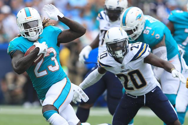 <p>Jay Ajayi #23 of the Miami Dolphins runs the ball during the game against the Los Angeles Chargers at the StubHub Center on September 17, 2017 in Carson, California. (Photo by Sean M. Haffey/Getty Images) </p>