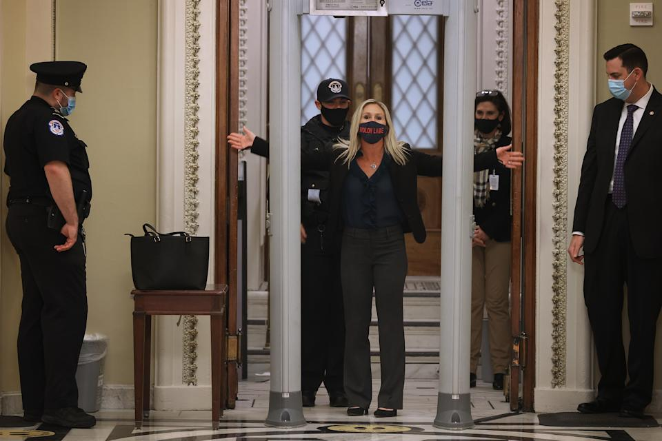 Rep. Marjorie Taylor Greene (R-GA) is searched by U.S. Capitol Police after setting off the metal detector outside the doors. (Photo by Chip Somodevilla/Getty Images)