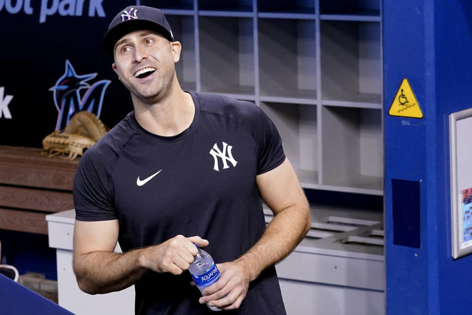 New York Yankees right fielder Joey Gallo looks out from the dugout before the team's baseball game against the Miami Marlins, Friday, July 30, 2021, in Miami. Gallo was acquired from the Texas Rangers in a trade. (AP Photo/Lynne Sladky)