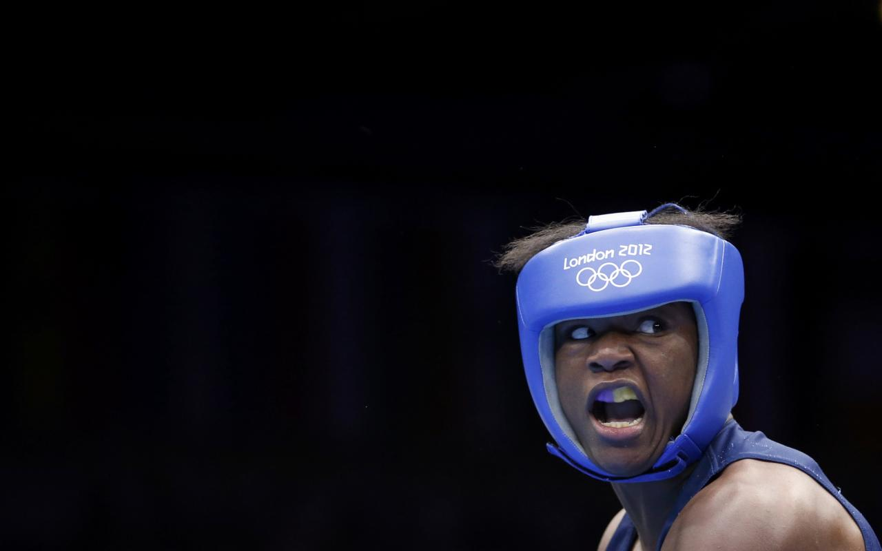 Claressa Shields of the U.S. fights Kazakhstan's Marina Volnova (not shown) during their Women's Middle (75kg) semi-final boxing match at the London Olympic Games August 8, 2012.      REUTERS/Damir Sagolj (BRITAIN  - Tags: SPORT BOXING OLYMPICS TPX IMAGES OF THE DAY)