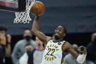 Indiana Pacers' Caris LeVert dunks the ball in the second half of an NBA basketball game against the Cleveland Cavaliers, Monday, May 10, 2021, in Cleveland. (AP Photo/Tony Dejak)