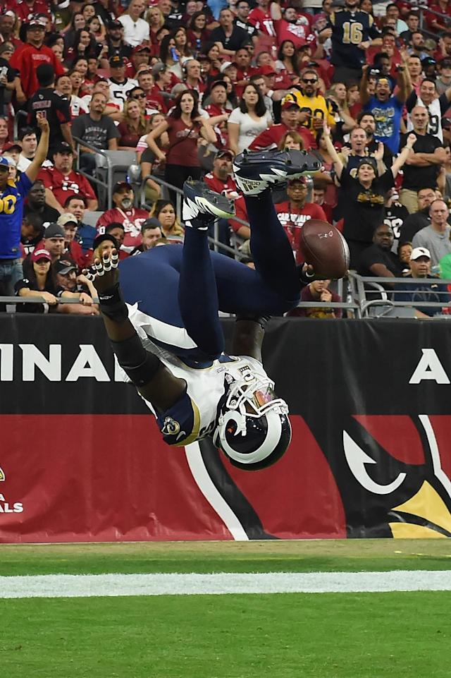 <p>Inside linebacker Alec Ogletree #52 of the Los Angeles Rams flips into the end zone on a 41-yard interception return for a touchdown during the first quarter of the NFL game against the Arizona Cardinals at the University of Phoenix Stadium on December 3, 2017 in Glendale, Arizona. (Photo by Norm Hall/Getty Images) </p>