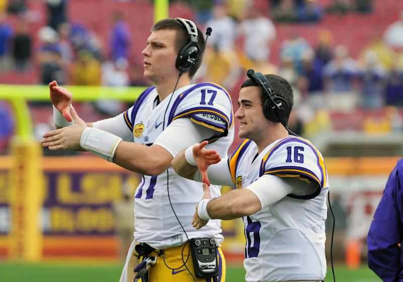 Former LSU QB Brad Kragthorpe #16 helps signal a play against Iowa in 2014. (Photo by Al Messerschmidt/Getty Images)