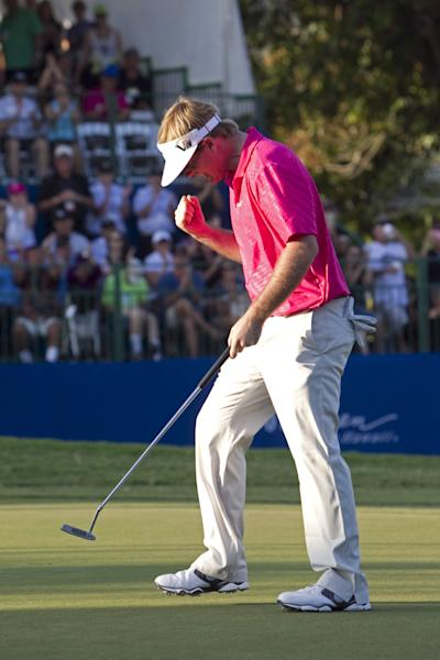 Russell Henley celebrates after sinking a birdie putt on the 18th green and winning the Sony Open golf tournament, Sunday, Jan. 13, 2013, in Honolulu. (AP Photo/Marco Garcia)