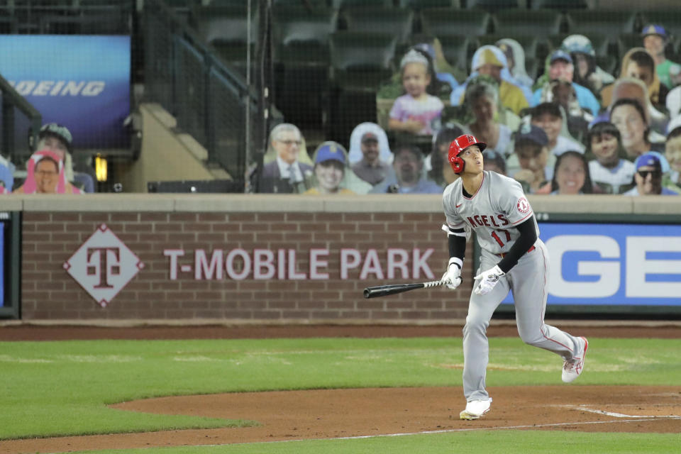 Los Angeles Angels' Shohei Ohtani watches his solo home run as he heads to first base during the second inning of a baseball game against the Seattle Mariners, Thursday, Aug. 6, 2020, in Seattle. (AP Photo/Ted S. Warren)