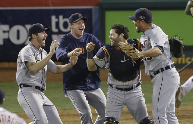 From left to right, Detroit Tigers pitcher Justin Verlander, pitcher Max Scherzer, catcher Alex Avila and pitcher Joaquin Benoit celebrate after the final out of the ninth inning of Game 5 of an American League baseball division series against the Oakland Athletics in Oakland, Calif., Thursday, Oct. 10, 2013. The Tigers won 3-0. (AP Photo/Jeff Chiu)