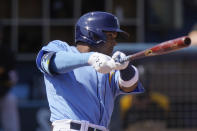 Tampa Bay Rays' Wander Franco, hits a home run in the second inning during a spring training baseball game against the Pittsburgh Pirates on Wednesday, March 3, 2021, in Port Charlotte, Fla. (AP Photo/Brynn Anderson)