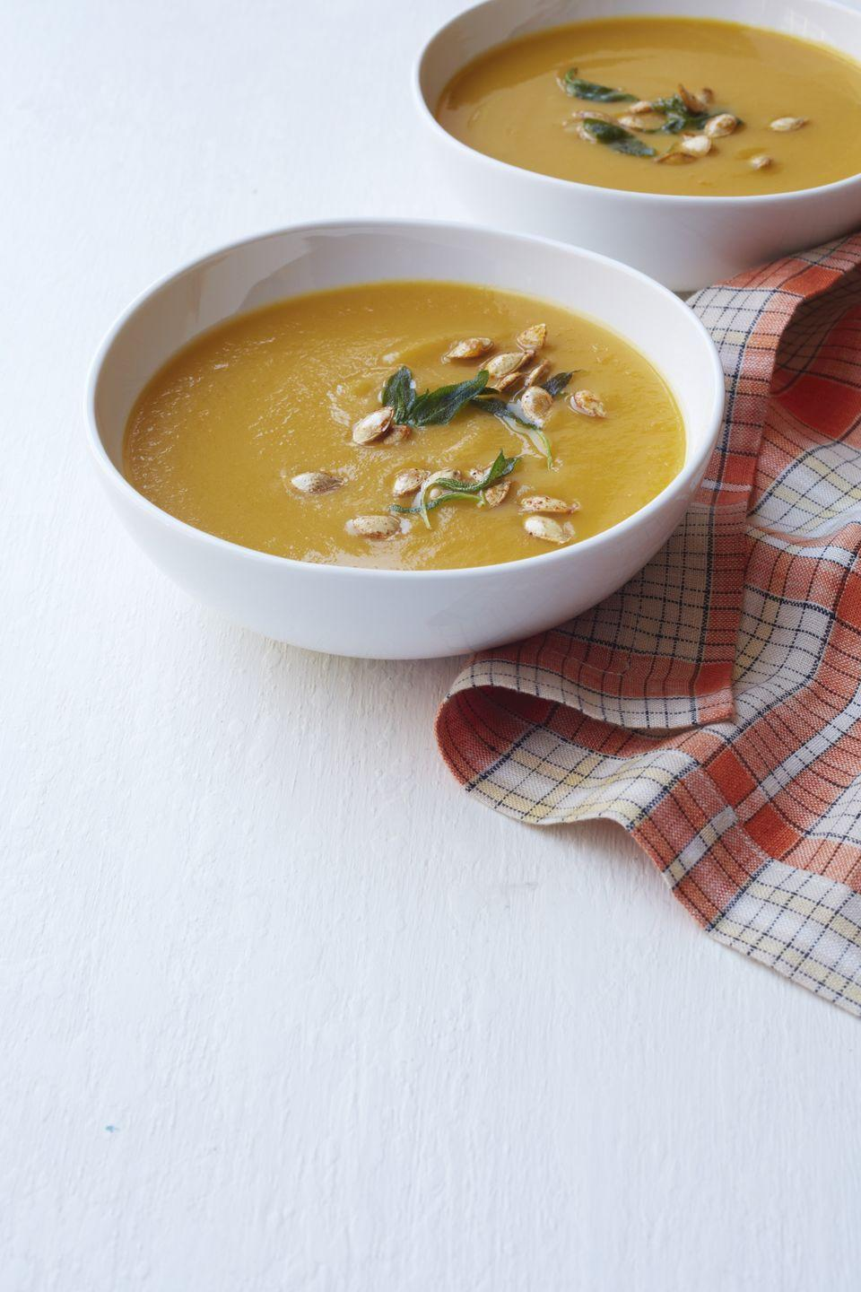 """<p>This sweet and hearty vegetarian soup is supremely satisfying on a chilly fall day. To make it more filling, consider adding chickpeas or white beans.</p><p><em><a href=""""http://www.womansday.com/food-recipes/food-drinks/recipes/a12291/butternut-squash-carrot-soup-recipe-wdy1013/"""" rel=""""nofollow noopener"""" target=""""_blank"""" data-ylk=""""slk:Get Butternut Squash and Carrot Soup recipe"""" class=""""link rapid-noclick-resp"""">Get Butternut Squash and Carrot Soup recipe</a>. </em></p>"""