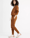 """<p>Made from organic cotton and recycled polyester, the Madewell MWL Sweatpants and Hoodie Sweatshirt are brushed on both sides making them extra soft to the touch. The fabric is thick and warm without being overly baggy or bulky. </p> <p><strong>Sizes available:</strong> XXS to XXL</p> <p><strong>$65 for the sweatshirt</strong> (<a href=""""https://www.anrdoezrs.net/links/8984085/type/dlg/sid/allurecozyloungewear/fragment/start%3D39/https://www.madewell.com/mwl-hoodie-sweatshirt-MB105.html?dwvar_MB105_color=BR6283&dwvar_MB105_size=XXS&cgid=apparel-topstees-sweatshirts"""" rel=""""nofollow noopener"""" target=""""_blank"""" data-ylk=""""slk:Shop Now"""" class=""""link rapid-noclick-resp"""">Shop Now</a>) and <strong>$70 for the sweatpants</strong> (<a href=""""https://www.anrdoezrs.net/links/8984085/type/dlg/sid/allurecozyloungewear/https://www.madewell.com/mwl-sweatpants-99106032878.html?source=googlePLA&noPopUp=true&srcCode=Paid_Search%7CShopping_NonBrand%7CGoogle%7CMWGGBS00002_99106032878_1508320780_53557874290_488433664731_c_pla_online__9004372&gclsrc=aw.ds&&gclid=EAIaIQobChMI6_3539HE7QIVumDmCh3k0QbAEAYYASABEgIgHPD_BwE&gclsrc=aw.ds"""" rel=""""nofollow noopener"""" target=""""_blank"""" data-ylk=""""slk:Shop Now"""" class=""""link rapid-noclick-resp"""">Shop Now</a>)</p>"""