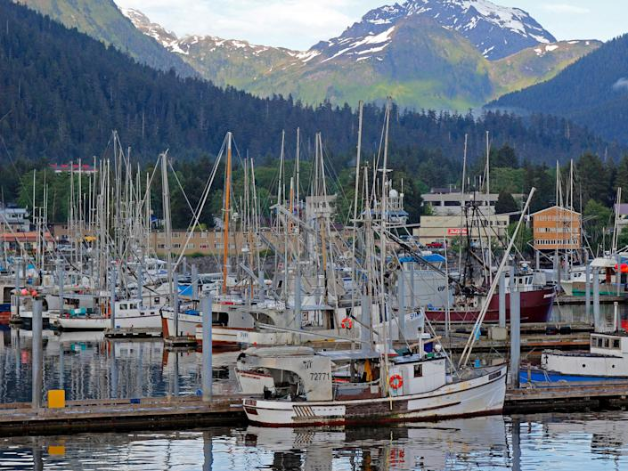 fishing boats in front of mountains in skita alaska