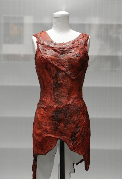 "In this photo taken June 14, 2011,the dress made of meat worn by Lady Gaga at the 2010 MTV Video Music Awards is shown in the vault of the Rock and Roll Hall of Fame and Museum to be shown in the Women Who Rock exhibit in Cleveland, Ohio. The dress has made its way to Washington, along with Loretta Lynn's song about ""The Pill"" and other relics from music history. Lady Gaga's dress from the 2010 MTV Video Music Awards is being displayed at the National Museum of Women in the Arts with an explanation of her political message. (AP Photo/Mark Duncan, file)"