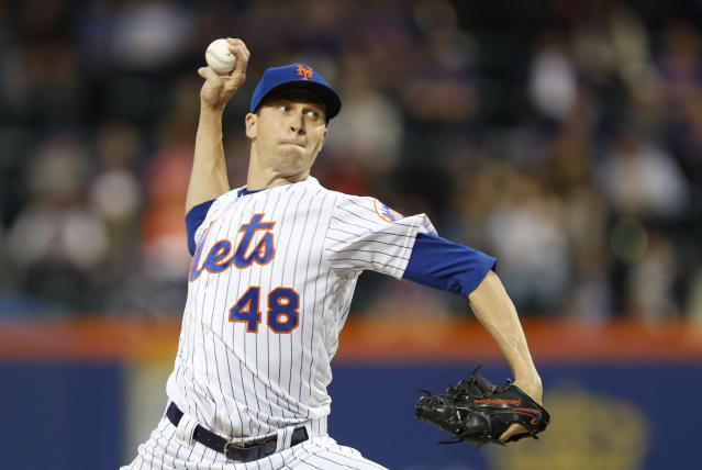 New York Mets starting pitcher Jacob deGrom winds up during the second inning of the team's baseball game against the St. Louis Cardinals, Thursday, June 13, 2019, in New York. (AP Photo/Kathy Willens)