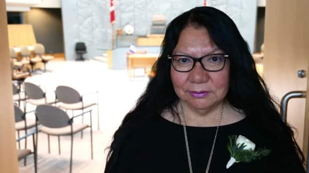 Frieda Martselos, MLA for Thebacha, called on the N.W.T. government in the last sitting of the Legislature to demolish both schools in Fort Smith, N.W.T., because they are former residential schools  (Mario De Ciccio/Radio-Canada - image credit)