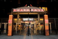 An entrance to Busch Stadium, home of the St. Louis Cardinals, remain closed Friday, Aug. 7, 2020, in St. Louis. Major League Baseball announced Friday night that the entire three-game series between the Chicago Cubs and Cardinals set for this weekend in St. Louis has been postponed after two more Cardinals players and a staff member tested positive for the coronavirus. (AP Photo/Jeff Roberson)