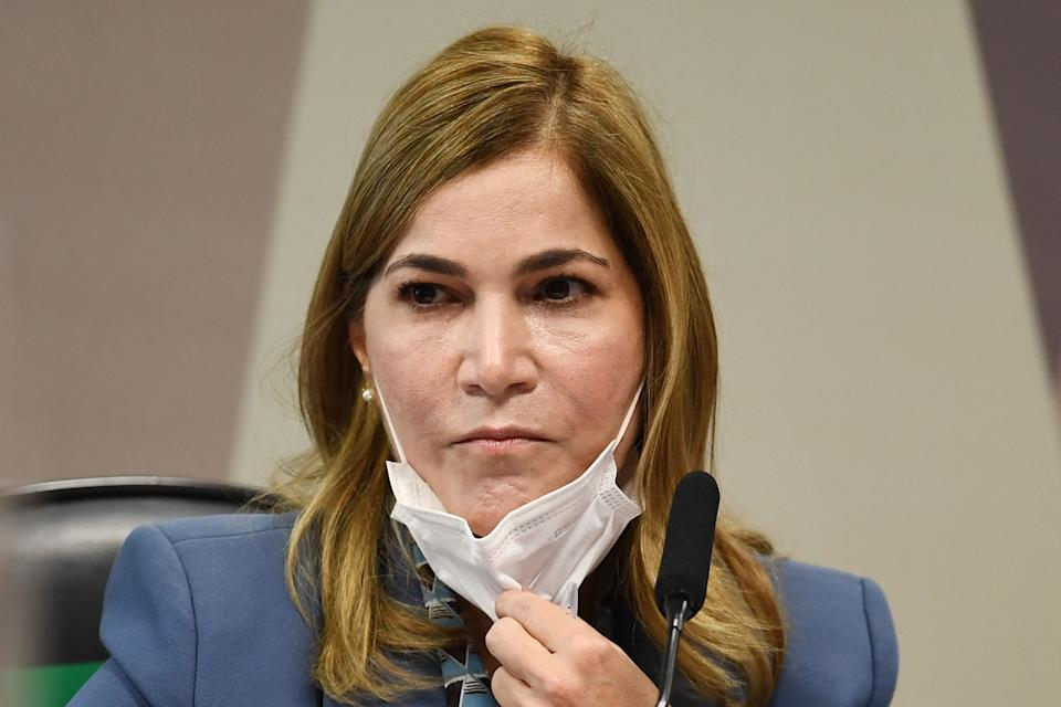 The Secretary of Labor Management of the Brazilian Ministry of Health, Mayra Pinheiro, removes her face mask during a session of the Parliamentary Committee of Inquiry that investigates the government's handling of the coronavirus pandemic, in Brasilia on May 25, 2021. - Brazil has spent the past weeks immersed in wall-to-wall coverage of a Senate inquiry into why COVID-19 exploded so horribly in the country -- a parade of damning, sometimes comical testimony likely to damage President Jair Bolsonaro. (Photo by EVARISTO SA / AFP) (Photo by EVARISTO SA/AFP via Getty Images)