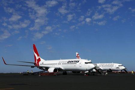 A Qantas Airlines Boeing 737 plane sits next to a Virgin Australia Boeing 737 plane at the Port Hedland airport in the Pilbara region of western Australia