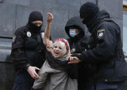 "Police detain an activist from Ukrainian female rights organization ""Femen"" on the International Day for the Elimination of Violence against Women as she protested naked in front of the Presidential Office in Kyiv, Ukraine, Wednesday, Nov. 25, 2020. Femen is demanding the Ukrainian authorities to ratify the Istanbul Convention on the protection of women. (AP Photo/Efrem Lukatsky)"