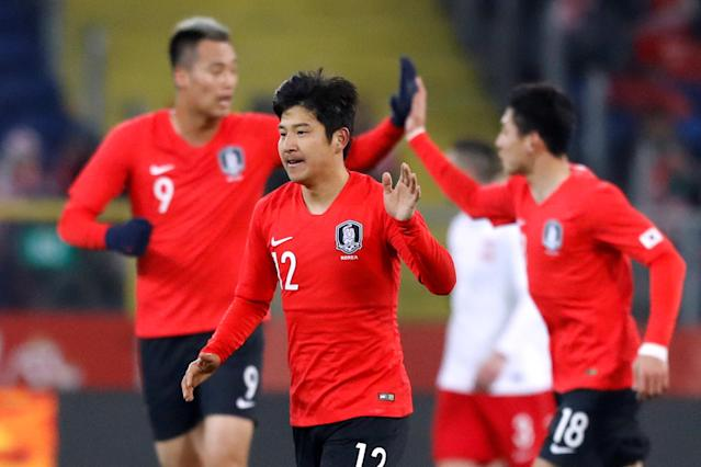 Soccer Football - International Friendly - Poland vs South Korea - Silesian Stadium, Chorzow, Poland - March 27, 2018 South Korea's Park Joo-Ho celebrates after teammate Hwang Hee-chan scores their second goal REUTERS/Kacper Pempel