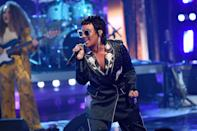 Demi amped up the glam for their on-stage look. Channeling Elton John, their silk suit was embroidered with flowers and crystals that complimented their silver statement sunnies and jewelry beautifully.