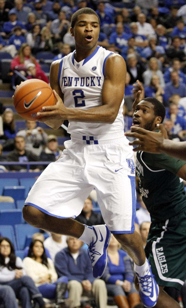 Kentucky's Aaron Harrison (2) looks for an open team mate next to Eastern Michigan's Anthony Strickland (33) during the second half of an NCAA college basketball game, Wednesday, Nov. 27, 2013, in Lexington, Ky. Kentucky won 81-63. (AP Photo/James Crisp)