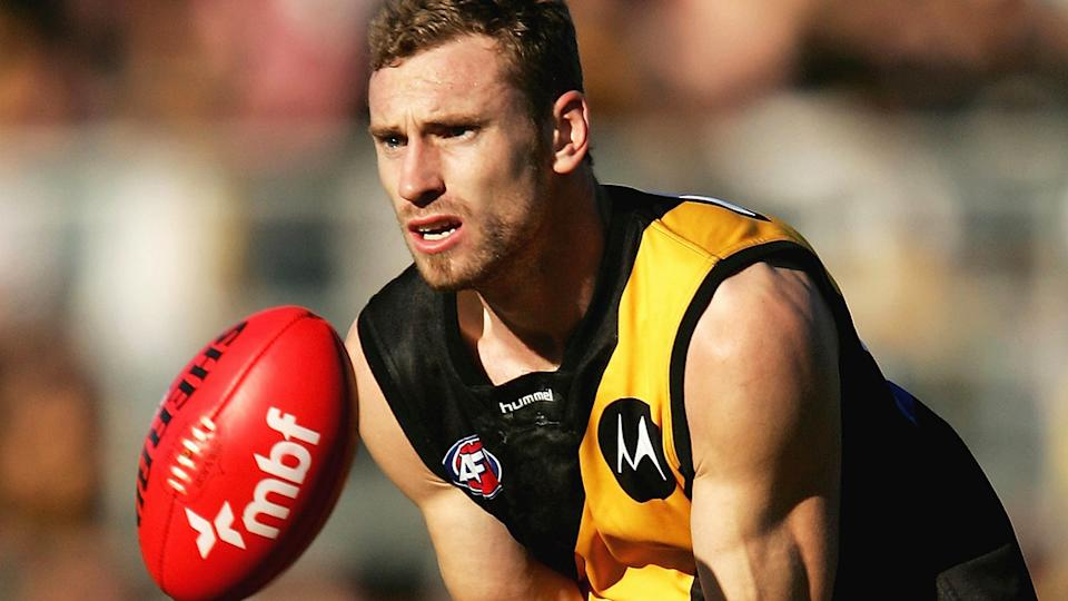Former Richmond Tigers player Shane Tuck is pictured playing in 2006. Tuck was found dead on Monday, aged 38.  (Photo by Ryan Pierse/Getty Images)