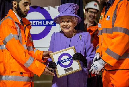 FILE PHOTO: Britain's Queen Elizabeth attends the formal unveiling of the new logo for Crossrail, which is to be named the Elizabeth line, at the construction site of the Bond Street station in central London, February 23, 2016.   REUTERS/Richard Pohle/Pool/File Photo